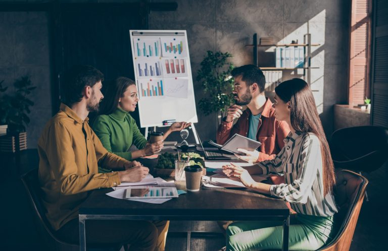 Experience group student people gather big dark office workstation sit desk table partners ceo marketer analyze start up development aims tell  innovation money capital project